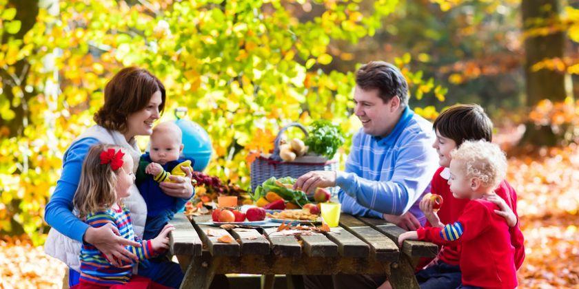 Family having picnic in autumn